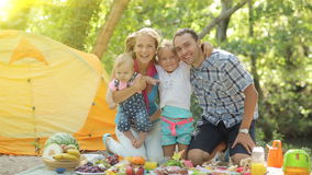 Portrait of happy family with two young children. Where all love each other in nature stock footage