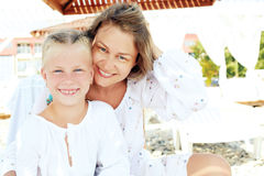 Portrait of a happy family vacationing by the sea Royalty Free Stock Photos