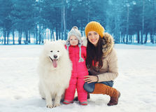Portrait of happy family in winter day, mother and child walking Royalty Free Stock Photography