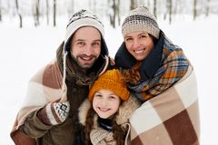 Happy Family Posing in Winter Forest stock photos