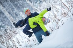 Portrait of a happy family in winter park. Father, son and little daughter laughing. Portrait of a happy family in winter park. Father and sons laughing, outdoor Stock Images
