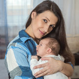 Portrait of a happy family. A woman with a newborn baby Royalty Free Stock Photos