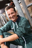 Portrait of happy farmer in barn Stock Photo