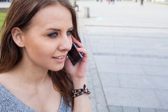 Portrait of a happy fashion woman with mobile phone. In a backgr Stock Photo