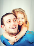Portrait of a happy father and a beautiful girl Stock Image