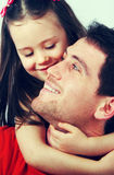 Portrait of a happy father and little girl royalty free stock photo