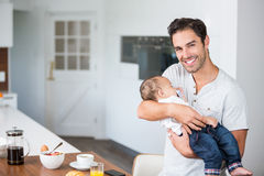Portrait of happy father carrying baby Royalty Free Stock Photography