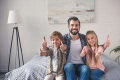 portrait of happy father and children stock images