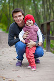 Portrait of happy father with daughter in the park Royalty Free Stock Photo