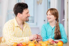 Portrait of happy father and her daughter with fruits stock photo
