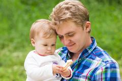 Portrait of happy father and his adorable little daughter in nature stock image