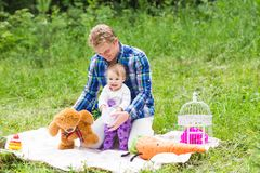 Portrait of happy father and his adorable little daughter in nature royalty free stock images