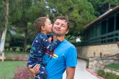 Portrait of a happy father with his little son on vacation. Little boy kisses and hugs his father. Happy fathers day.Happy family. Positive human emotions royalty free stock photos