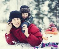Portrait of happy father with his son outside with Royalty Free Stock Images
