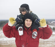 Portrait of happy father with his son outside with snowman Stock Photo