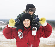 Portrait of happy father with his son outside in winter landscape, lifestyle people concept, real family together Royalty Free Stock Photo