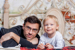 Portrait Of Happy Father with his to kid. Portrait of a father with his to kid at home Stock Image