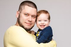 Portrait of happy father posing with lovely smiling child. stock photo