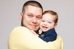 Portrait of happy father posing with lovely smiling child. royalty free stock photo