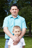 Portrait of happy father and son. The portrait of the father and the son, stay in park together Royalty Free Stock Image