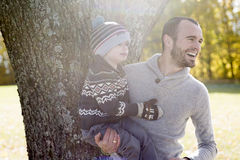 Portrait of happy father son in autumn park Stock Photography