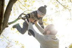 Portrait of happy father with son in autumn park Stock Photo