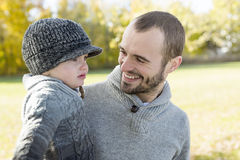 Portrait of happy father son in autumn park Royalty Free Stock Images