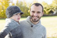 Portrait of happy father son in autumn park Royalty Free Stock Image