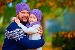 Portrait of happy father and son embracing in autumn park Stock Photography