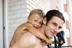 Portrait of happy father with son hugging outside Royalty Free Stock Image