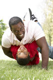 Portrait of Happy Father and Son In Park Stock Photography