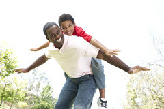 Portrait of Happy Father and Son In Park Stock Photo
