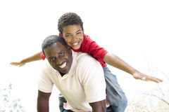 Portrait of Happy Father and Son In Park stock images