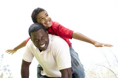 Portrait of Happy Father and Son In Park Royalty Free Stock Photography
