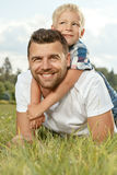 Portrait of happy father and son in the park. Portrait of happy young father and son in the park Stock Images