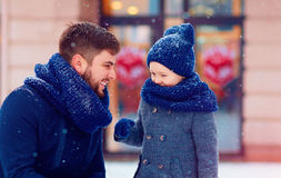 Portrait of happy father and son under winter snow. Portrait of happy father and son together under winter snow Stock Images
