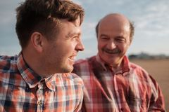 Portrait of happy father and son walking outdoors. They look on each other. Concept of good releationship between generations Stock Images