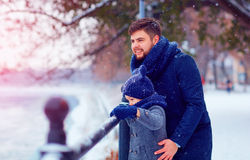 Portrait of happy father and son on winter walk in city Stock Image