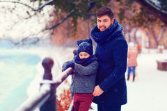 Portrait of happy father and son on winter walk in city Stock Photos