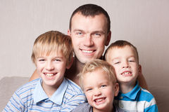 Portrait of a happy father with sons. Royalty Free Stock Images