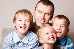 Portrait of a happy father with sons. Stock Image