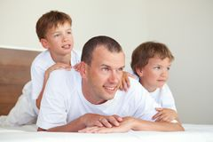 Portrait of happy father and sons Stock Photos
