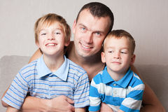 Portrait of a happy father with two sons. Royalty Free Stock Photography