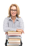 Portrait of happy female advocate leaning on books. Teacher at table with books on white background Stock Image