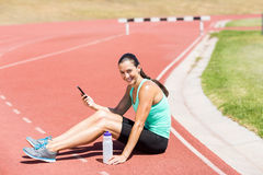 Portrait of happy female athlete using mobile phone Royalty Free Stock Photography