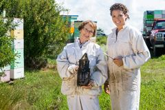 Portrait Of Happy Female Beekeepers Royalty Free Stock Images