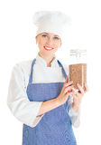 Portrait of happy female chef cook with buckwheat. Stock Photos
