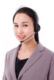Portrait of happy female customer service executive with headset Stock Photo