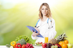 Portrait Of Happy Female Dietician. With Fresh Vegetables royalty free stock images
