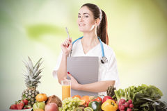 Portrait Of Happy Female Dietician. With Fresh Vegetables And Diary royalty free stock image